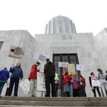 Protestors rallied against GMOs during a special session at the Oregon State Capitol in Salem in September 2013.