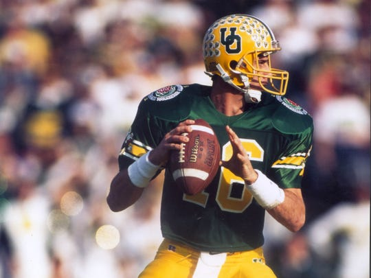 "Ducks quarterback Danny O""Neil gets set to throw a pass for Oregon in the 1995 Rose Bowl against Penn State."