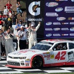 Kyle Larson does a burnout in Victory Lane after winning Saturday's Nationwide race.