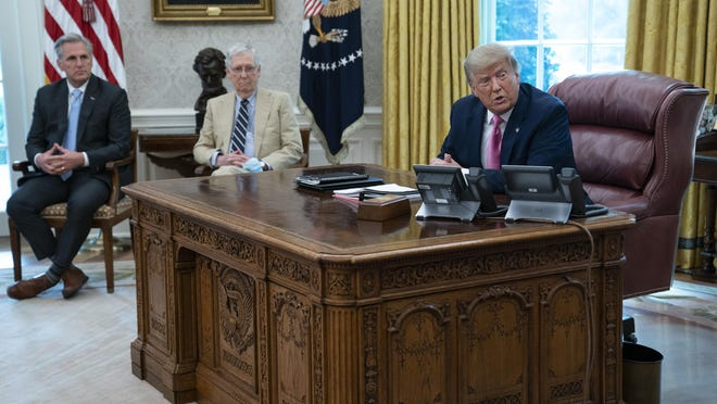 President Donald Trump speaks during a meeting with Senate Majority Leader Mitch McConnell of Ky., and House Minority Leader Kevin McCarthy of Calif., in the Oval Office of the White House, Monday, July 20, in Washington.