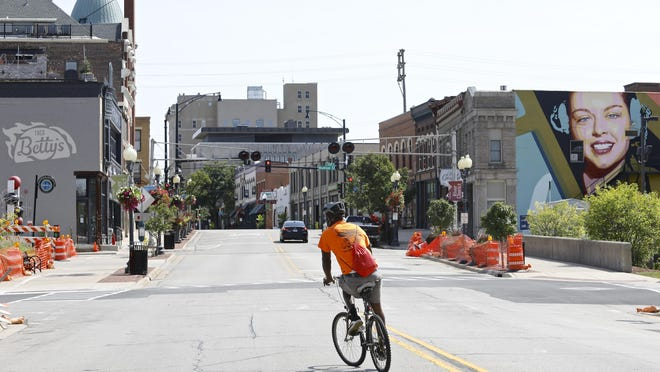 Kevin Gayden, 55, of Rockford, rides his bicycle Monday, Sept. 7, 2020, in downtown Rockford. The annual Labor Day parade and picnic, which typically draw thousands of participants and attendees, were canceled this year because of the ongoing coronavirus pandemic.