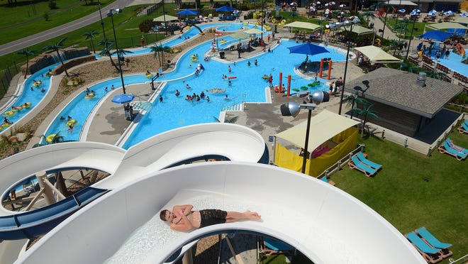 Swimmers and sliders cool off at Parrot Island Waterpark on Saturday, Aug. 15, 2020. Saturday was start of the park's Back To School Splash special event including prize drawings and games for all ages. The event continues today from 11 a.m. to 6 p.m., then Aug. 22-23, 29-30 and Sept. 5-7.