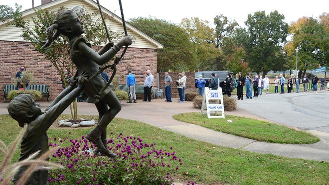 Voters line up at Creekmore Park on the first day of early voting. Creekmore is one of six early voting locations in the county.