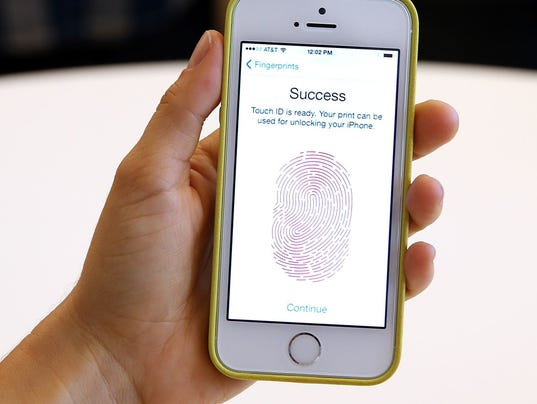 The new iPhone 5S with fingerprint technology is displayed during an Apple product announcement at the Apple campus on September 10, 2013 in Cupertino