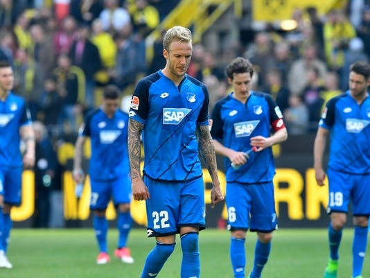 Hoffenheim's Kevin Vogt leaves the pitch with his team after the German Bundesliga soccer match between Borussia Dortmund and TSG Hoffenheim in Dortmund, Germany, Saturday, May 6, 2017. Dortmund defeated Hoffenheim with 2-1. (AP Photo/Martin Meissner)
