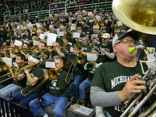 Alumni Band members play before the game against Northwestern on Friday, Dec. 30, 2016, at Breslin Center.