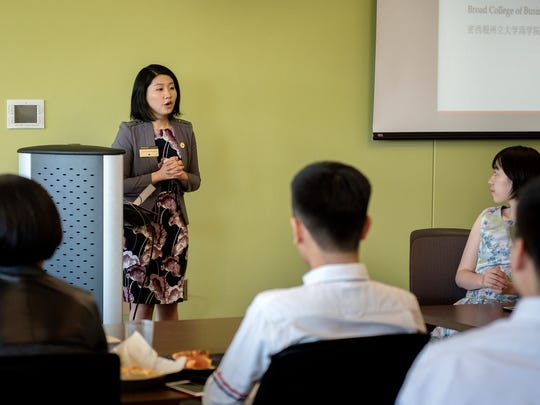 Skyin Yin, associate director of international advancement at Michigan State University, speaks during a presentation for Chinese students graduating from the Broad College of Business and their families on Saturday, May 5, 2018, at Brody Hall on the MSU campus in East Lansing.