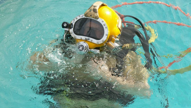 Taber MacCallum, chief executive officer of Tucson-based Paragon Space Development Corp., tests out the Paragon Dive System, a space suit-type outfit designed to protect divers in contaminated waters. The Tucson-based company is researching options for establishing a commercially operated, human space flight program.