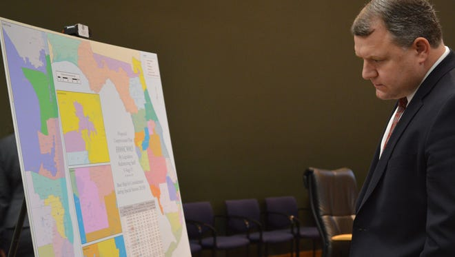 Sen. Rob Bradley, R-Orange Park,  ponders a redistricting map during the August special session.  the congressional redistricting map during joint legislative committee hearings during the special session.