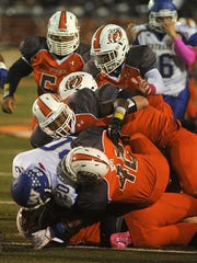 A wall of Tyger defenders stop Wooster's Tremaine