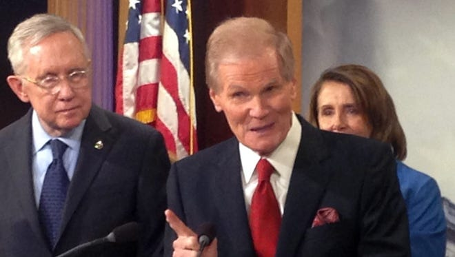 Sen. Bill Nelson, D-Fla., speaks at a news conference on the Zika virus in Washington on April 27, 2016. Behind him are Senate Minority Leader Harry Reid of Nevada and House Minority Leader Nancy Pelosi of California.,