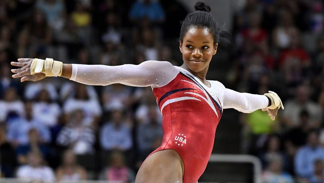 Gabby Douglas performs her floor exercise routine in the women's gymnastics' U.S. Olympic team trials Sunday, July 10, 2016, at the SAP Center in San Jose, Calif.