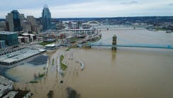 The Ohio River floods Smale Riverfront Park and Mehring