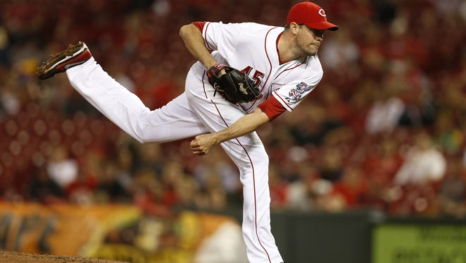 Cincinnati Reds relief pitcher Sean Marshall (45) works the mound against the Colorado Rockies at Great American Ball Park.