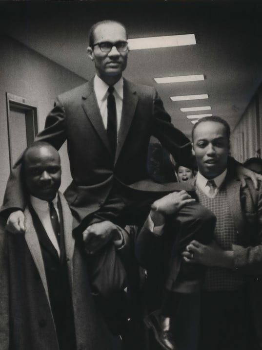 1964 Press Photo Supporters carried Lloyd A Barbee on their shoulders