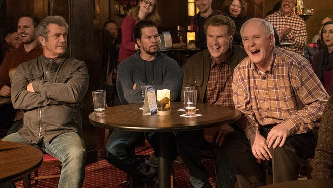 Like father, like son: Kurt (Mel Gibson, left), Dusty (Mark Wahlberg), Brad (Will Ferrell) and Don (John Lithgow) take in an improv comedy show in 'Daddy's Home 2.'