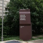 A sign stands outside the Internal Revenue Service (IRS) building in Washington, D.C.