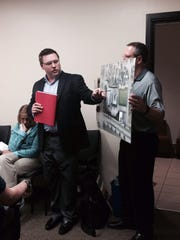 Kwik Trip's Troy Mleziva, left, makes a presentation Monday to the Wisconsin Rapids Planning Commission.
