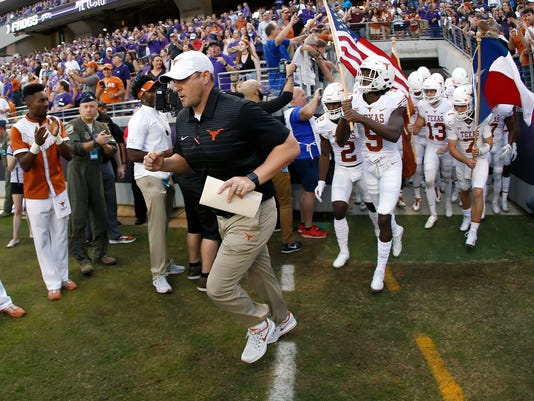Texas coach Tom Herman takes the field with his team before an NCAA college football game against TCU on Saturday, Nov. 4, 2017, in Fort Worth, Texas. TCU won 24-7. (AP Photo/Ron Jenkins)