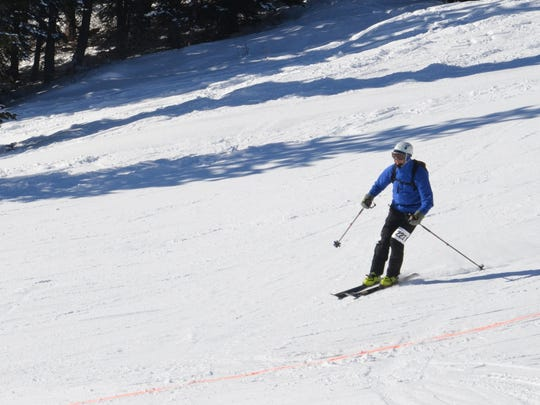 A racer skis down the slopes Saturday at the Jack'n'Jill Randonee Race at Teton Pass Ski Resort.