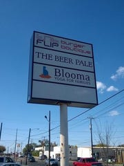The sign for The Beer Pale.