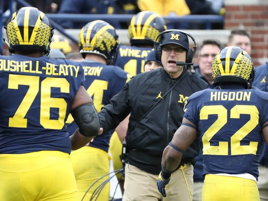 Michigan head coach Jim Harbaugh on the sideline during the third quarter Saturday.