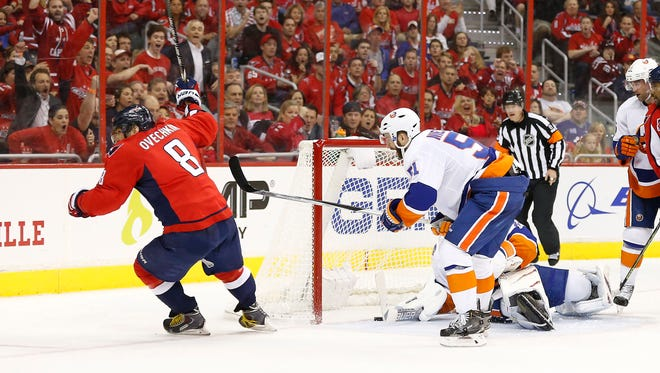 Washington Capitals left wing Alex Ovechkin (8) scores a goal on New York Islanders goalie Jaroslav Halak (41) in the second period in game two of the first round of the the 2015 Stanley Cup Playoffs at Verizon Center.