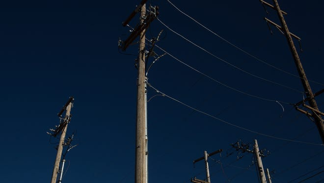 Utility lines run near an electric substation in Aztec, New Mexico, part of the region's electrical grid.