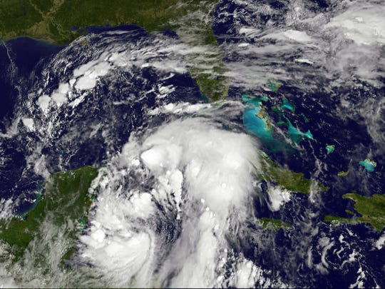 A satellite image shows Nate gaining strength Friday as it headed toward the Gulf Coast. After dumping heavy rains in Central America that left at least 22 people dead, Nate was upgraded to a Category 1 hurricane late Friday.