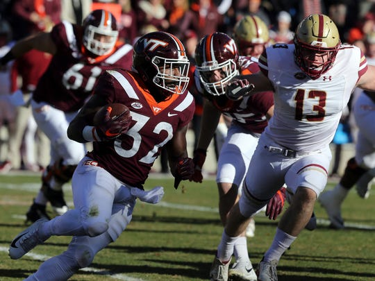 Virginia Tech running back Steven Peoples (32) looks to run up field in the first quarter of an NCAA college football game against Boston College in  Blacksburg Va., Saturday, Nov. 3, 2018. (Matt Gentry/The Roanoke Times via AP)
