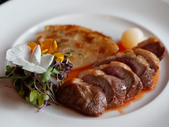 The pan seared duck with scallion pancake, mache and
