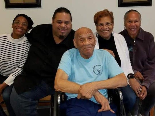 Kenneth Bowser, center, visits with, from left, grandchildren Tonya Cotton and Mark Cotton and daughters Sharon Van Leer and Janet Bowser at a locked forensic nursing home in St. Peter, Minn., in 2016. He was sent to the home after he fatally shot his son and caretaker, Larry, in 2015, and was deemed unfit to stand trial because of his dementia.