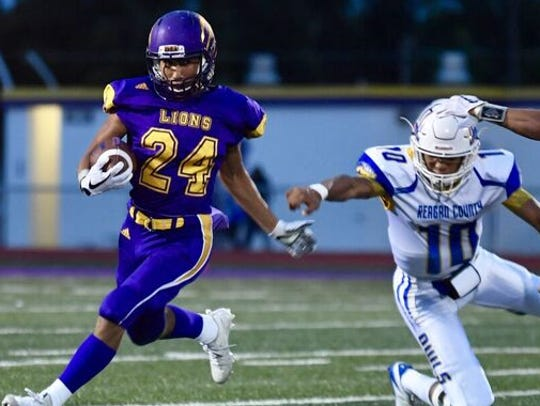 Ozona running back Zachary Talamantez (24) breaks away
