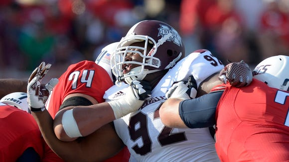 Sep 13, 2014; Mobile, AL, USA; Mississippi State Bulldogs defensive lineman Kaleb Eulls (92) battles South Alabama Jaguars offensive lineman Steven Foster (74) and offensive lineman Clay Machen (75) in the third quarter at Ladd-Peebles Stadium. Mississippi State defeated South Alabama, 35-3. Mandatory Credit: Glenn Andrews-USA TODAY Sports