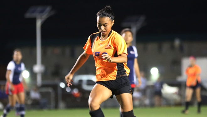 Personal Finance Center Lady Crushers' Skyylerblu Johnson takes the ball to the goal against Quality Distributors during a Week 7 match of the 2016 Bud Light Women's Soccer League Spring season Sunday at the Guam Football Association National Training Center. The Lady Crushers won 5-0.