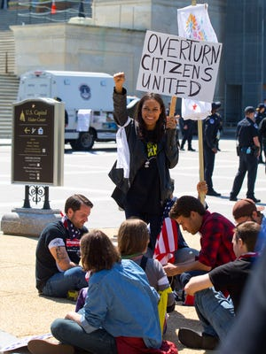 """Actress Rosario Dawson takes part in a """"Democracy Spring"""" demonstration on Capitol Hill in Washington, Friday, April 15, 2016."""