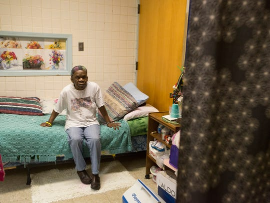 Heneritta Hood sits in her room at Friendship Mission on Tuesday, Sept. 6, 2016, in Montgomery, Ala.