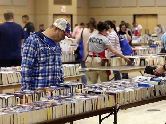 Book lovers search for new titles and authors during the Tom Green County Friends of the Library annual book sale at the McNease Convention Center on Saturday, March 25, 2017.