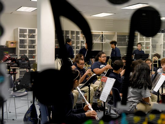 Instrumental music students wait for the beginning