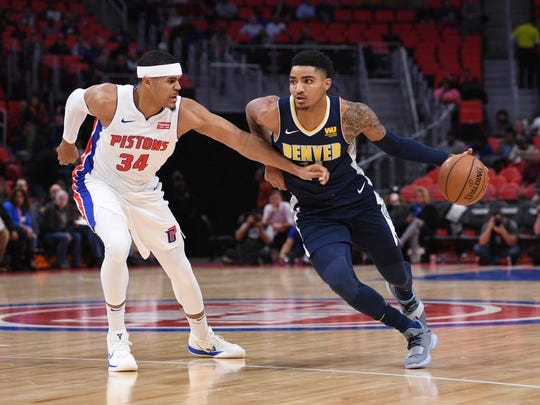 Nuggets guard Gary Harris (14) drives to the basket