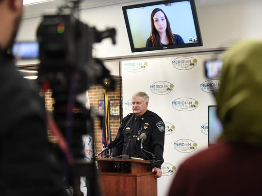 Meridian Township Police Chief Dave Hall speaks during