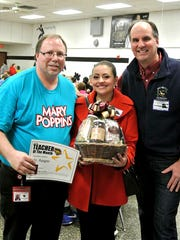 Pictured, from left, are: Andrew Apgar, music teacher at Dover Intermediate School; Paisley Corcovelos; and Dave Brown, vice president of Brown's Orchards