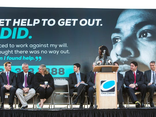 A billboard is unveiled at a press conference on the topic of sex trafficking in Phoenix, Wednesday, January 7, 2015.