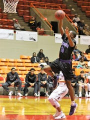 Haywood's Chris Jones (24) goes up for a shot against