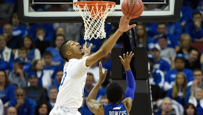 Kentucky forward Marcus Lee blocks the shot of Hampton guard Deron Powers during the first half  Thursday in Louisville.