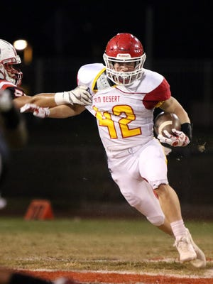 Palm Desert's Drake Hoffman runs the ball during the first half of the game against Palm Springs on Friday, October 13, 2017.
