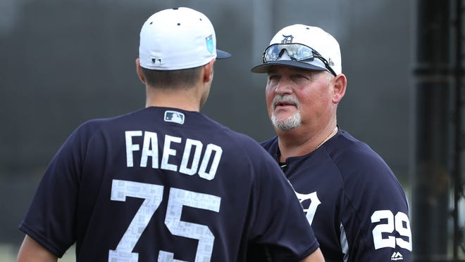 Pitching coach Chris Bosio talks with Detroit Tigers pitcher Alex Faedo after his first time facing major league hitters during Spring Training on Feb. 20, 2018 at Publix Field at Joker Marchant Stadium in Lakeland, Florida.