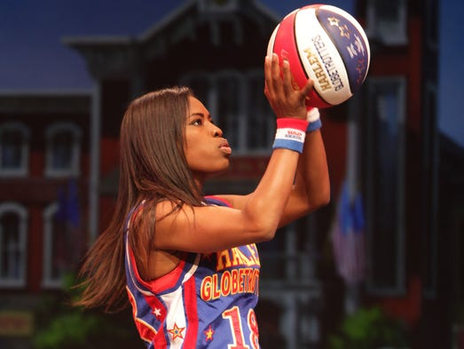 "Harlem Globetrotter Fatima ""TNT"" Maddox performs at a press conference at Silver Dollar City on Wednesday, August 13, 2014."