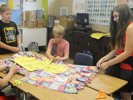 silverland middle school students are making blankets for project linus