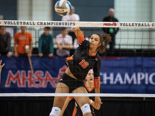 Northville's Layssa Imbuzerio (16) hitsna kill shot during MHSAA volleyball semifinals against Rockford at the Kellogg Arena in Battle Creek Friday evening.